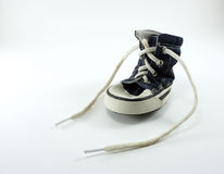 Jean fabric dog shoe with white leash Stock Images