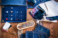 Jean fabric, jeans rivets, buttons, Denim jean tailor on wooden Stock Image