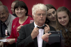 Jean Jacques Annaud with fans makes selfie on the red carpet before the opening 37 of the Moscow International film Festival Royalty Free Stock Photos