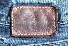 Jean leather tag. Old jean leather tag close up Royalty Free Stock Image