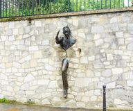 Jean Marais sculpture `Le Passe-Muraille` Man Who Walked through Walls, 1989 on Montmartre. Le Passe-Muraille is the title of a story by Marcel Ayme Stock Image