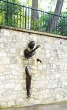 Jean Marais sculpture `Le Passe-Muraille`. Man Who Walked through Walls, 1989 on Montmartre. Le Passe-Muraille is the title of a story by Marcel Ayme Royalty Free Stock Images