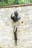 Jean Marais sculpture `Le Passe-Muraille`. Man Who Walked through Walls, 1989 on Montmartre. Le Passe-Muraille is the title of a story by Marcel Ayme Royalty Free Stock Photo