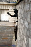 Jean Marais sculpture Le Passe-Muraille. PARIS, FRANCE - DEC 28, 2011 - Jean Marais sculpture Le Passe-Muraille (Man Who Walked through Walls, 1989) on Stock Photo