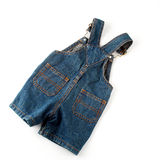 Jean overalls. Children's wear - jean overalls isolated over white background Royalty Free Stock Image