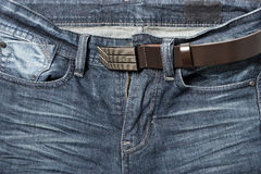 Jean pant with leather belt Stock Images
