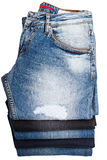 Jean Pants blu piegato ed impilato Fotografia Stock Libera da Diritti