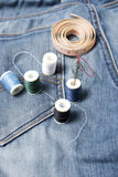 Jean pants and sewing Stock Photography