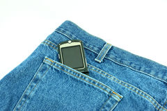 Jean Pocket with Cell Phone. The back of a pair of denim blue jeans with a cell phone sticking out from the pocket Stock Photo