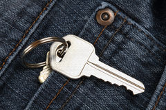 Jean pocket with a key. A close-up view of a jean pocket with a house key Royalty Free Stock Photography