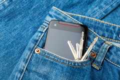 Jean pocket with mobile and key Stock Images