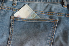 Jean pocket with a partly seen Ukrainian banknote Stock Photography