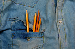 Jean shirt With pencils Stock Images