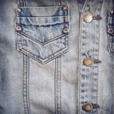 Jean shirt with pocket and metal button on clothing Royalty Free Stock Photography