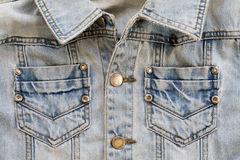 Jean shirt with pocket and metal button on clothing Royalty Free Stock Photos