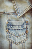 Jean shirt with pocket and metal button on clothing Royalty Free Stock Images