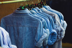 Jean shirt. On rack with retro color tone Royalty Free Stock Photo
