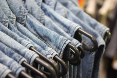 Jean shirts on hanger. On market Stock Photo