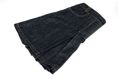 Jean,skirt. Folded jean skirt isolated on white background Royalty Free Stock Photography
