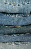 Jean stack. A pile of jeans in shades of blue royalty free stock photography