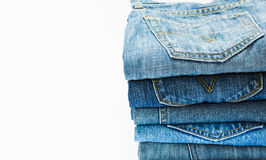 Jean. Stack of blue jeans on white background Royalty Free Stock Image