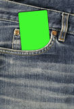 Jean texture with pocket and empty card. Jean texture with pocket and green empty card Stock Photography