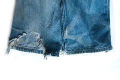 Jean torn. Old jean torn on white background royalty free stock photo