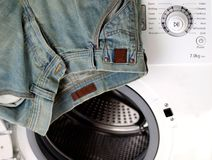 Jean on a washinh machine Royalty Free Stock Photo