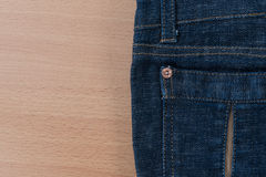 Jean on wood background Stock Photography