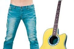 Jean y guitarra Imágenes de archivo libres de regalías