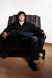 Jeandre on chair 2 Stock Photos