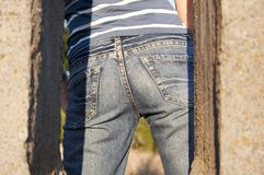 Jeans 03. Jeans and striped t-shirt stock photo