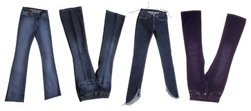 Jeans. Four jeans trousers isolated on white background Royalty Free Stock Photography
