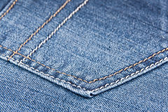 Jeans. Denim texture blue with stitching. The pocket Royalty Free Stock Photo