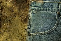 Jeans 2. Closeup of faded jeans against a grunge background Stock Image