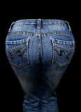 Jeans. Blue jeans on black background stock photos