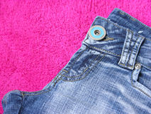 Jeans. Blue jeans on the carpet Royalty Free Stock Photos