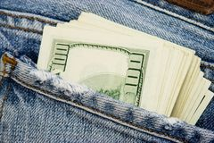 Jeans. Money in the pocket of jeans stock photo