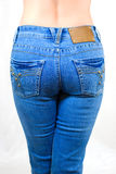 Jeans. Female nates, hardly fitted by jeans Stock Photo