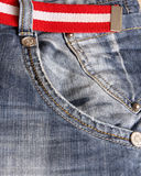 Jeans. Fashion jeans with striped red and white belt Stock Photo