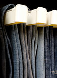Jeans. Hanging in closet Royalty Free Stock Photos
