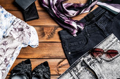 Jeans and accessories on wooden boards Stock Photos