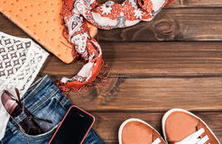 Jeans and accessories on wooden boards Stock Image