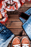 Jeans and accessories on wooden boards Stock Images