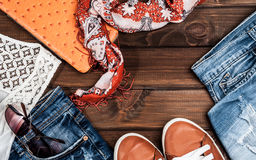 Jeans and accessories on wooden boards Stock Photography