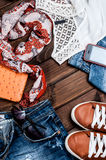 Jeans and accessories on wooden boards Stock Photo
