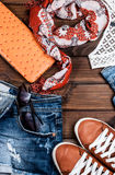 Jeans and accessories on wooden boards Royalty Free Stock Photos