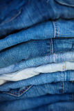 Jeans in Assorted Shades of Blue, Folded and On Display Stock Images