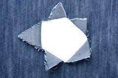 Fond - jeans avec des trous et endroit pour le texte photographie stock