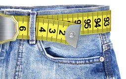 Jeans avec le régime de ceinture de mètre Images libres de droits